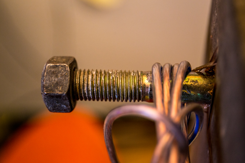 Nuts serve as leveling devices, and bolts as a cord storage location